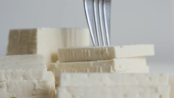 Thumbnail for Close-up taking cow milk cheese  with fork slow motion footage