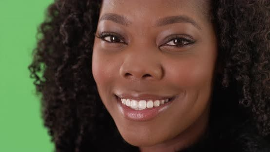 Thumbnail for Close up of lovely black female with pretty smile on greenscreen to be keyed