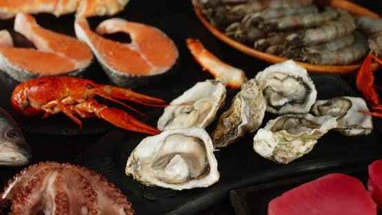Thumbnail for Different Types of Seafood Slowly Rotate on the Table.