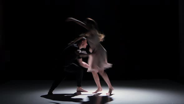 Thumbnail for Man and Woman Performing a Contemporary Dance on Black, Shadow