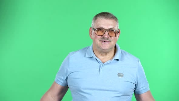 Thumbnail for Portrait of Aged Man Looking at the Camera with Excitement, Isolated Over Green Background.