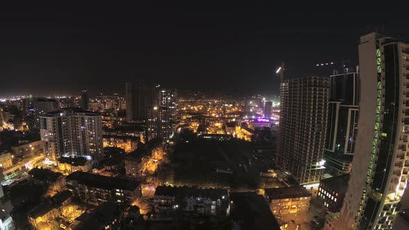Thumbnail for Building Construction From Day To Night. Timelapse. Tower Crane with Lighting in City Space