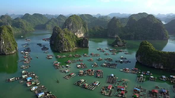 Cover Image for High Aerial View Floating Village in Bay and Boundless Islands