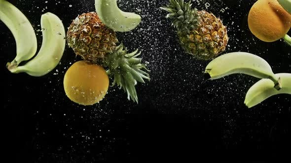 Thumbnail for Fresh Tropical Fruits Pineapple Oranges Lemons and Banana Falling Into Water on Black Background