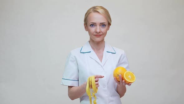 Thumbnail for Nutritionist Doctor Healthy Lifestyle Concept - Holding Orange Fruit
