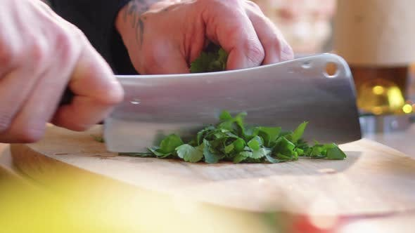 Thumbnail for Chopping Fresh Parsley with Butcher Knife