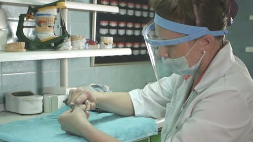 Dental Technician Making of Denture in a Dental Lab