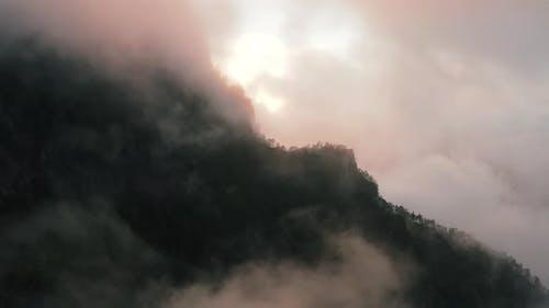 Aerial View Of Mystical Cloud Coverage Over The Mountains in Caldera de Taburiente park La Palma