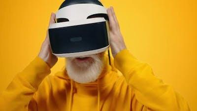 Senior Man Trying Virtual Glasses Indoors