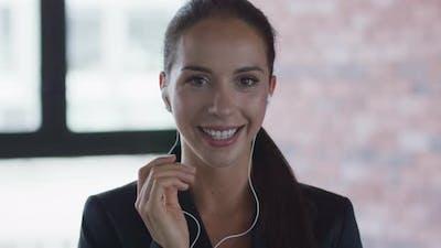 Businesswoman in Earphones Answering Call