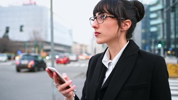Thumbnail for Businesswoman using smart phone in city