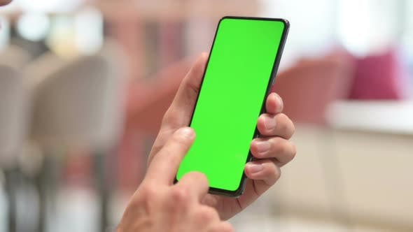 Close Up of Man Using Smartphone with Chroma Screen