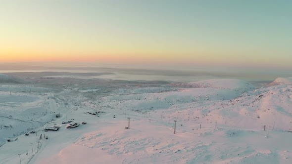 Thumbnail for Aerial Shot of Sunrise in Winter Mountains
