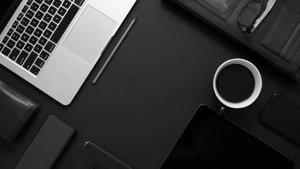 Thumbnail for Business Desktop Concept. Mix of Office Supplies and Gadgets on a Black Table Background