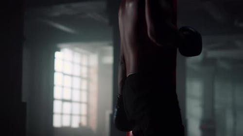Athlete Exercising with Punch Bag