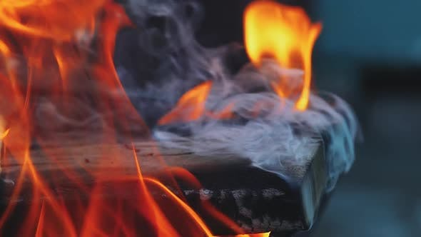 Wooden Board is Smoldering Under the Influence of a Hot Flame