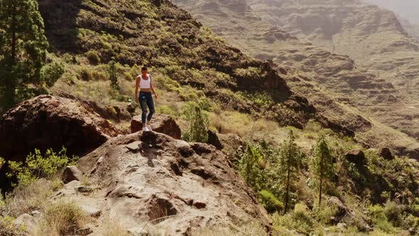 Thumbnail for Fit Model Walking Towards the Huge Boulder in Gran Canaria Valley