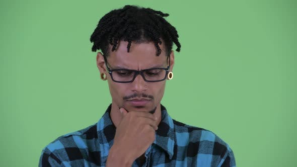 Thumbnail for Face of Stressed Young African Hipster Man Thinking and Looking Down