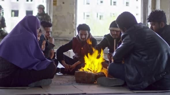 Thumbnail for Refugees Warming Hands before Fire