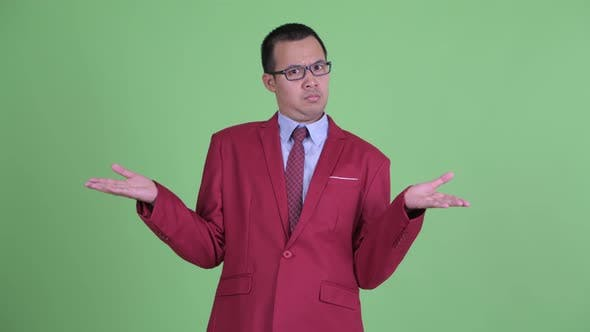 Thumbnail for Funny Asian Businessman with Eyeglasses Shrugging Shoulders