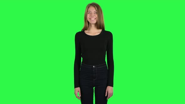 Cover Image for Young Woman Smiling While Looking at Camera and Laughing. Green Screen