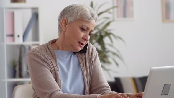 Thumbnail for Elderly Female Office Worker Having Phone Call