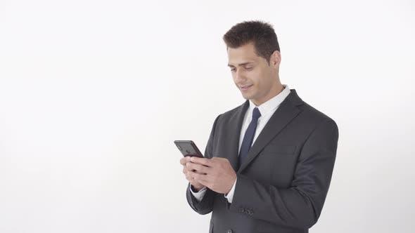 Successful Businessman Using Telephone