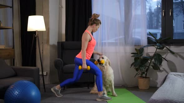 Fit Woman with Dog Doing Lunge Excercise at Home