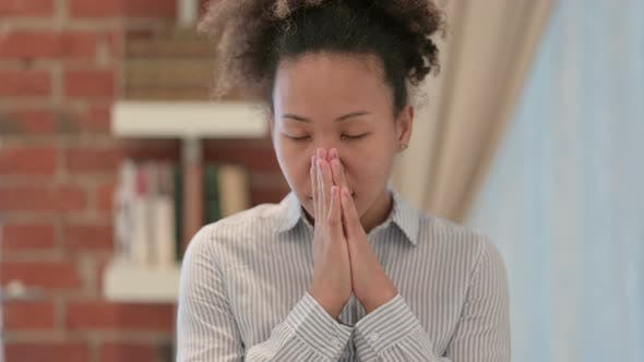 Portrait of African American Woman Praying