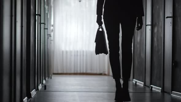 Thumbnail for Silhouette of Woman Walking along Hallway