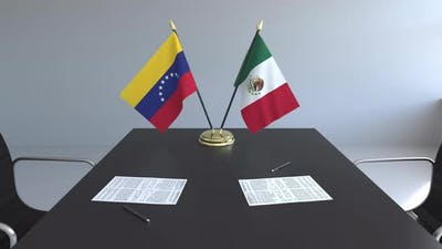 Flags of Venezuela and Mexico and Papers