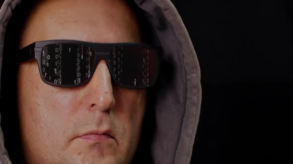 Thumbnail for Man in Hood and Eyeglasses with Digital Rain Matrix