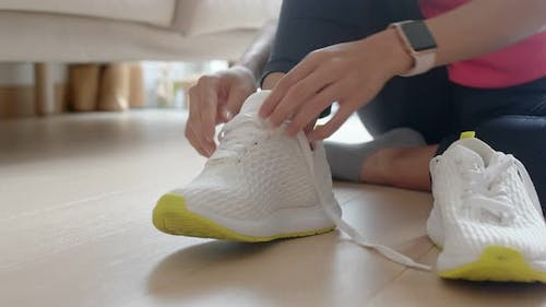 Woman wear sport shoes and prepare for running
