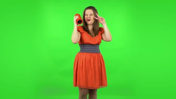 Thumbnail for Cute Girl Is Listening To Music with Bluetooth Portable Speaker and Dancing
