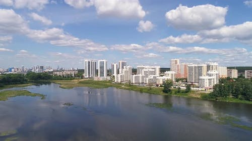 Aerial view of Modern multi-storey houses on the river bank in the city. 03