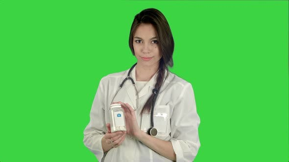 Thumbnail for Smiling Female Doctor Looking at Camera and Holding Bottle of Pills on a Green Screen, Chroma Key