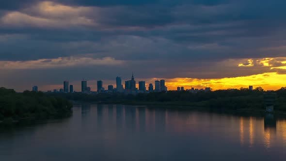 Thumbnail for View on Cityscape of Warsaw City Buildings and Wisla River at Sunset. Time lapse