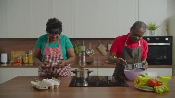 Thumbnail for Elderly Black Family Preparing Homemade Dough