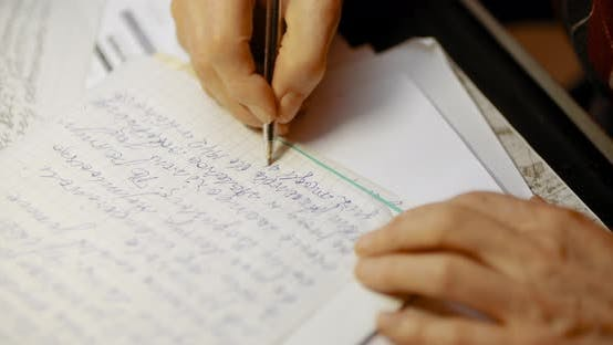 Thumbnail for Senior Businessman Writing on Paper at Table in Office