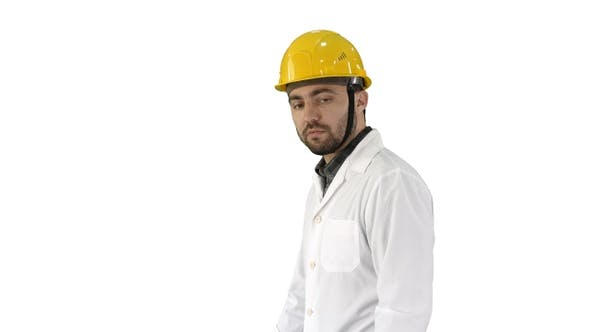 Cover Image for Unhappy construction site engineer talking and walking