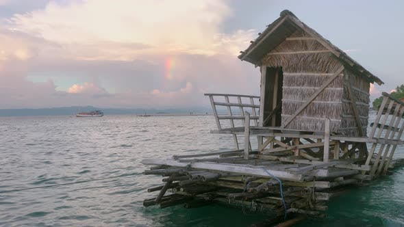 Thumbnail for Evening Rainbow and Floating Hut