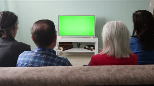Family Watching TV. Green Screen.