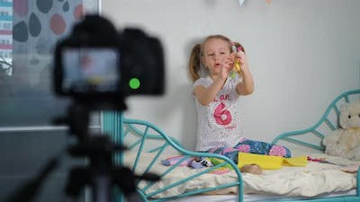 Little Girl Recording Vlog About Selfmade Toys