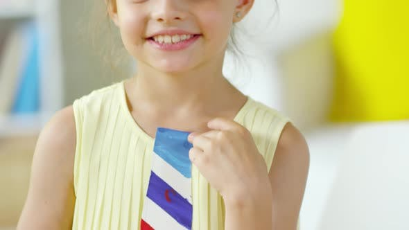 Thumbnail for Cute Little Girl Smiling and Posing with Handmade Paper Tie