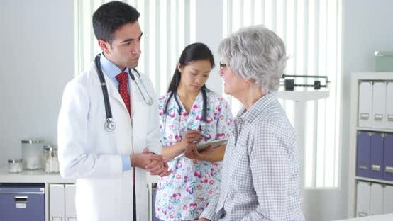 Thumbnail for Hispanic doctor talking with elderly patient