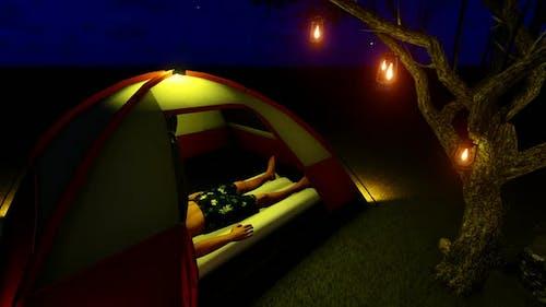 Man Sleeping in Tent at Night