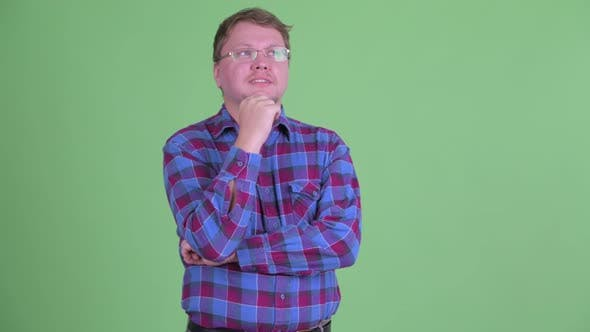 Thumbnail for Happy Overweight Bearded Hipster Man Thinking and Looking Up