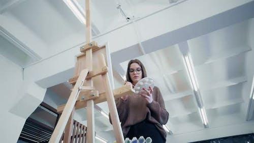 Female Artist Paints Picture
