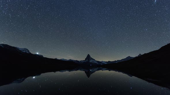 Cover Image for Incredible Night View of Stellisee Lake with Matterhorn Peak in Swiss Alps