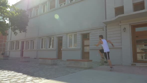 Thumbnail for Free Runner Performing in City Street